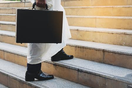 Arab businessman holding bag successful
