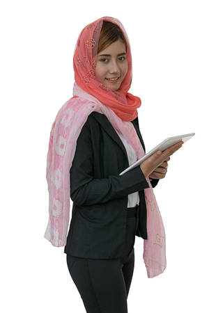 clipping  messaging: Muslim woman messaging on a mobile phone isolated background with clipping path.
