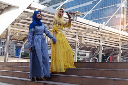 Fashion portrait of two young beautiful muslim woman wearing hijab Lizenzfreie Bilder