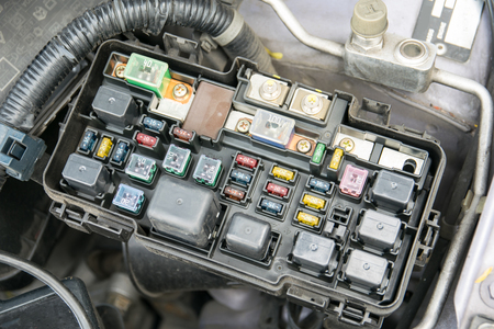 Detail of a car engine bay with fuses Stock Photo