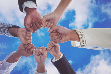 Diverse People Hands Fists Together Partnership