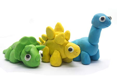 Play dough dinosaur on white background