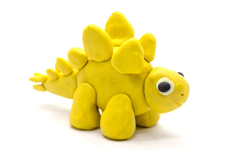 Play dough Stegosaurus on white background Archivio Fotografico