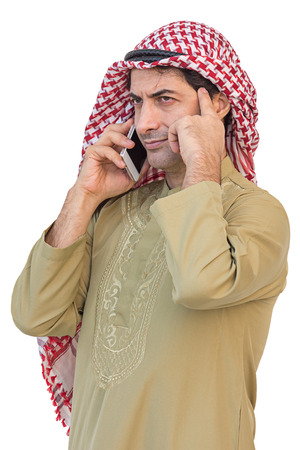 Arab businessman messaging on a mobile phone isolated background with clipping path. Banque d'images