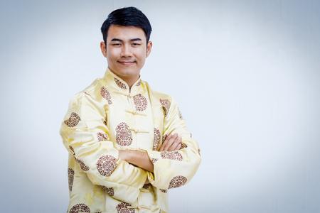 Felice uomo cinese in abito tradizionale Archivio Fotografico - 93453645