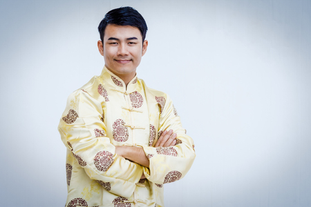 Happy Chinese man in traditional dress