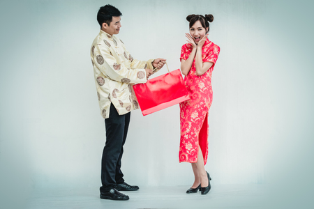 Asian couple holding shopping bag. Chinese new year.