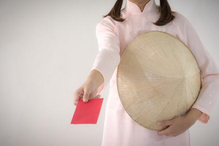 Vietnam woman holding red envelope, woman wear Vietnamese, Vietnamese new year