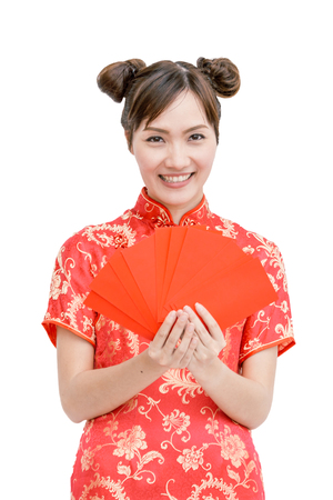 Chinese woman holding red envelope, isolated background Stock Photo