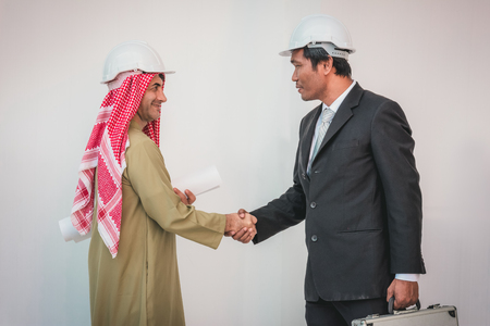 Arab businessman and foreman worker handshaking