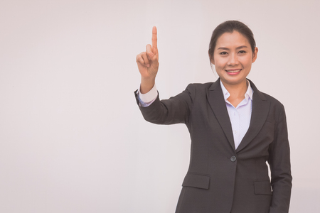 happy young businesswoman with hands up.