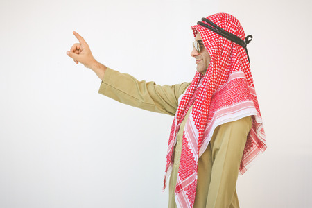 happy young Arab businessman with hands up.