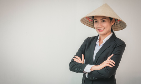 businesswoman wearing Vietnamese hat Standard-Bild