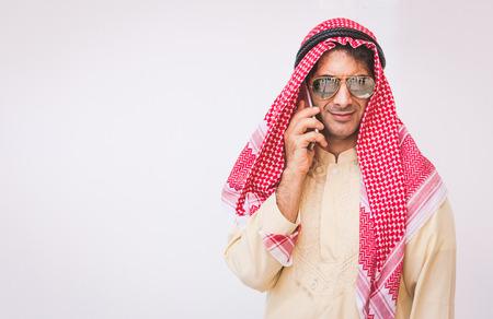 Arab businessman useing on a mobile phone Banque d'images
