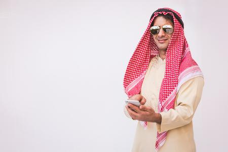 Arab businessman useing on a mobile phone Standard-Bild