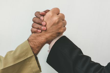 Arab businessman and businessman worker handshaking