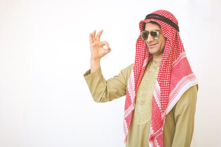 Arab businessman pointing up ok hand sign Standard-Bild