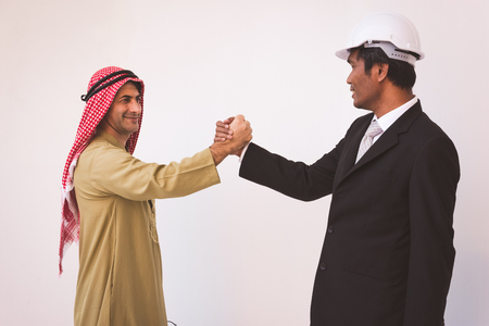Arab businessman and foreman worker handshaking