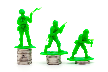 Toy Soldier on coin stacks a white background
