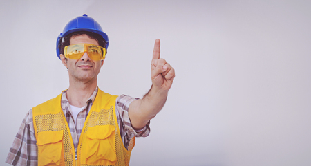 Arab engineer man wear blue cap safety helmet Foto de archivo