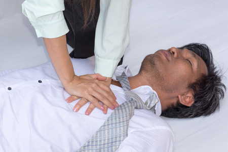 First Aids Emergency CPR on Heart Attack Man Stock Photo - 104035121