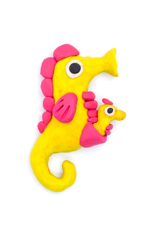 Play dough sea horse on white background