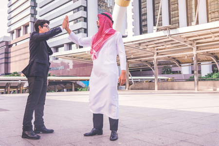 Arabic businessman giving an high five to his business partner, on construction site Archivio Fotografico