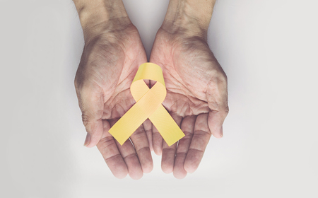 Childhood cancer awareness gold ribbon