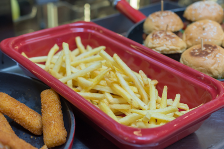 Closeup of home made French fries and burgers