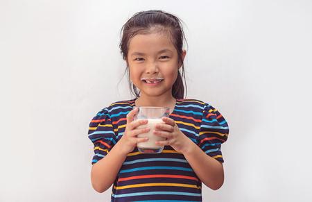 Cute little girl with glass of milk 版權商用圖片