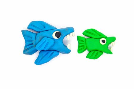 Play dough big fish eat little fish on white background