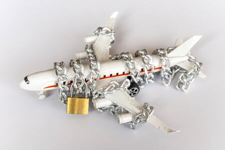 Airplane with chain and padlock, Safety concept.