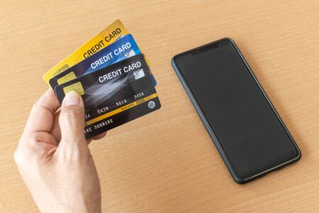 Man holding credit cards and smartphone. On-line shopping on the internet using a smartphone