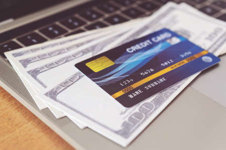 Credit card and money on a computer keyboard. shopping online concept, Online payment
