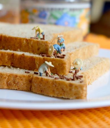 Miniature Farmer on Bread Stock Photo - 75137206