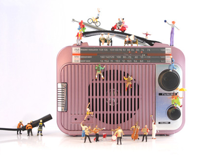 Music Station Surrounded by Miniature People Stock Photo - 87322854