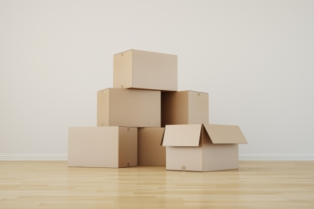 3d rendering of cardboard boxes in a empty room