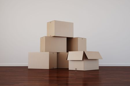 shipped: 3d rendering of cardboard boxes in a empty room with dark wood floor Stock Photo