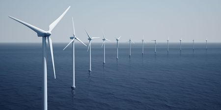 3d rendering of windturbines on the ocean photo
