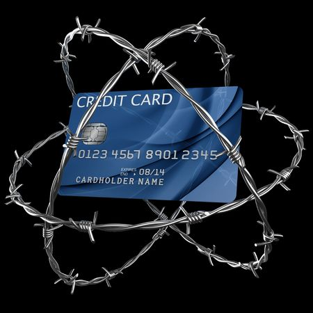 3d rendering of a credit card wrapped in barbed wire photo