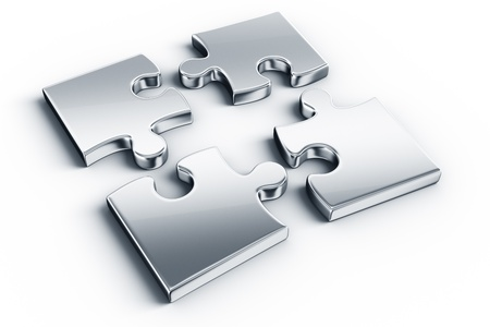 four objects: Metal puzzle pieces on a white floor
