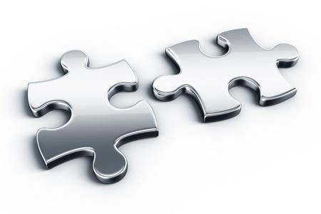 puzzle pieces: Metall-Puzzle-Teile auf einem wei�en Boden