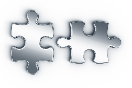 two pieces: Metal puzzle pieces on a white floor seen from the top Stock Photo
