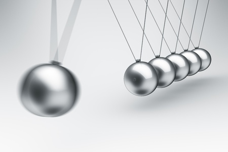 newton cradle: 3d rendering of a Newtons cradle with one ball about to impact