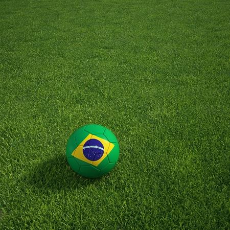 3d rendering of a Brazilian soccerball lying on grass Foto de archivo