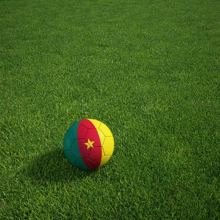cameroonian: 3d rendering of a Cameroonian soccerball lying on grass Stock Photo
