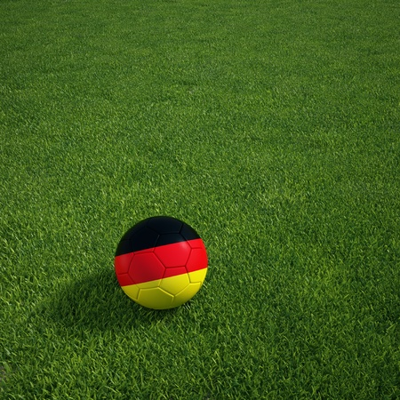 soccerball: 3d rendering of a German soccerball lying on grass Stock Photo