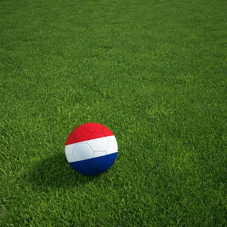 3d rendering of a Dutch soccerball lying on grass photo
