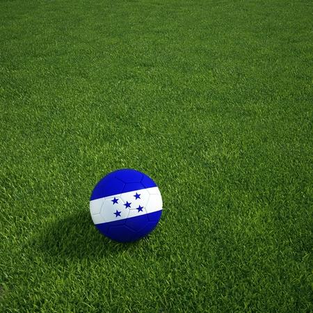 bandera honduras: Representación 3D de un balón de fútbol de Honduras tirado en la hierba
