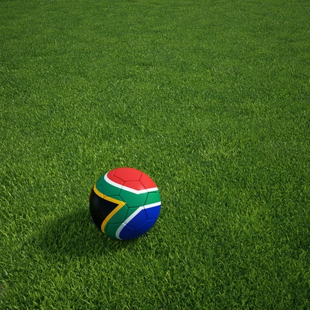 south african: 3d rendering of a South african soccerball lying on grass Stock Photo